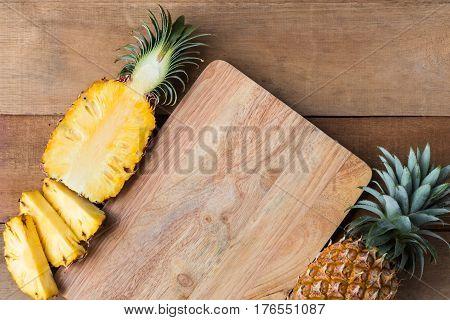 pineapple slice on wood cut board top view