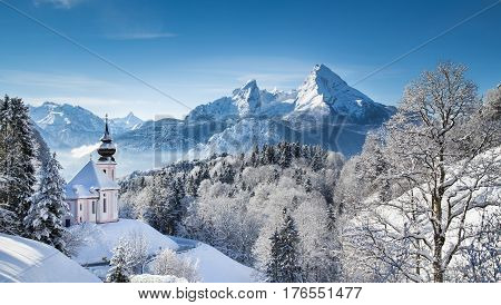 Panoramic View Of Beautiful Winter Landscape In The Bavarian Alps With Pilgrimage Church Of Maria Ge