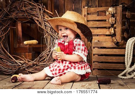 Cheerful girl child dressed in country style
