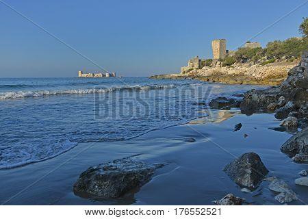 The Maiden's Tower (Turkish: Kız Kulesi) or Kizkalesi on island in sea. Corycus ruins in foreground. Turkey.