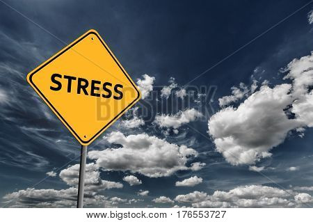 Background of dark blue sky with cumulus clouds and yellow road sign with text Stress
