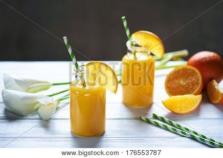 Fresh Orange Juice In The Mason Jar On Wood Table