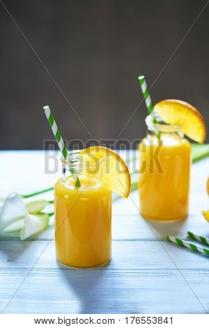 Fresh Orange Juice In The Mason Jar On Wood Table