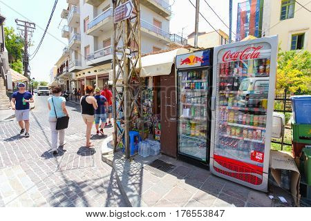 Rethymnon Island Crete Greece - June 23 2016: The small market stall with street refrigerators with various cold drinks on the street of part Old Town in Rethymnon for tourists and local citizens