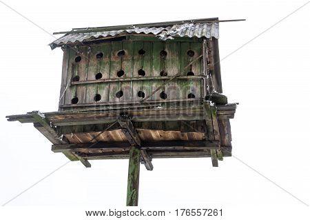 Old Ukrainian wooden dovecote against white background