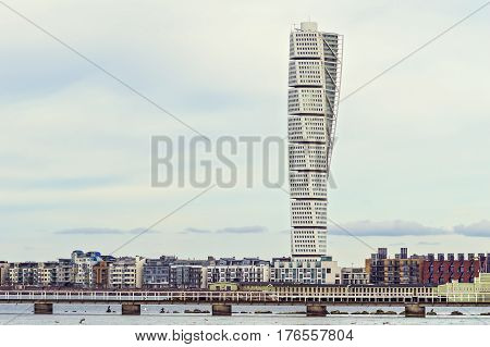 MALMO SWEDEN - March 12. 2017. The west harbor area with the Turning Torso on March 12 2017 in Malmo Sweden. Malmo is the capital city in Skane county also the third largest city in Sweden.