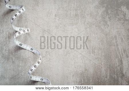 Measure Tape On Concrete Table