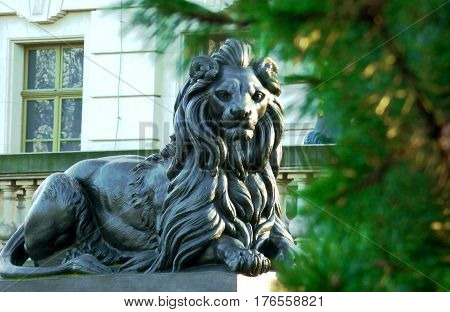 Majestic lion statue near the old castle