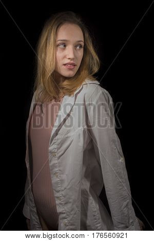 Young girl with white shirt on black background
