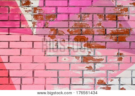 Old colorful (pink purple and white) paint with cracks on brick wall as background texture