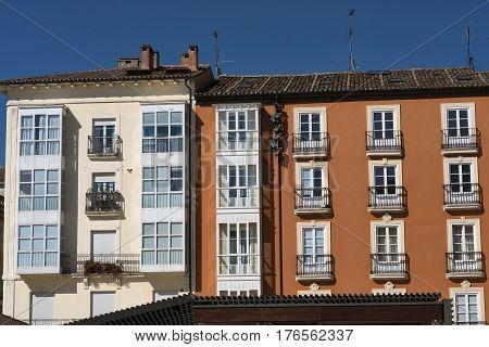 Burgos (Castilla y Leon Spain): facade of historic buildings with balconies and verandas