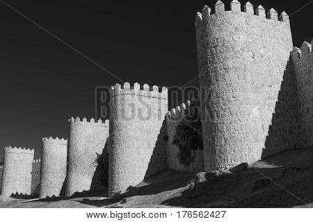 Avila (Castilla y Leon Spain): the famous medieval walls surrounding the city. Black and white