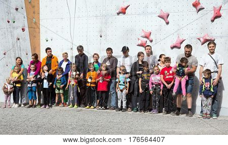 Participants of Family Climbing Competitions at opening ceremony, fathers, mothers, children, in groups. Family Climbing Competitions Mother, Father and Me , Dnipro, Ukraine, September 18, 2016