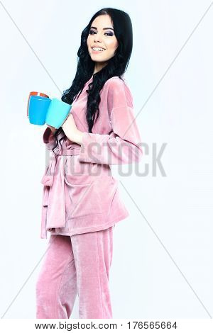 Smiling Girl In Pink Velour Pajama Home Suit With Cup