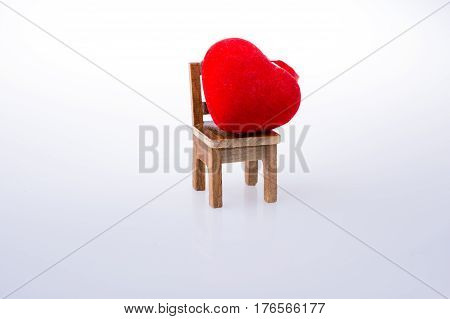 Little Red Color Heart Shape On A Chair