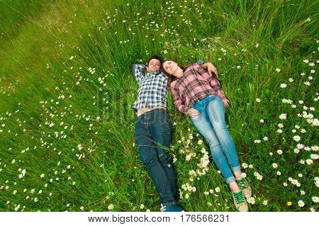 Loving couple having fun on summer vacation. Portrait of a happy couple laughing.Young couple in love outdoors. Summer holidays love.
