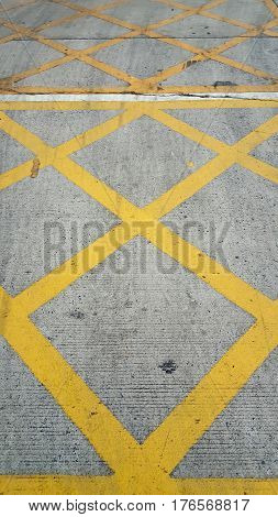 Grungy yellow road paint pattern and background