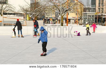 BurghausenGermany-January 1,2015: People go ice skating at a rink in BurghausenGermany on New Year's day