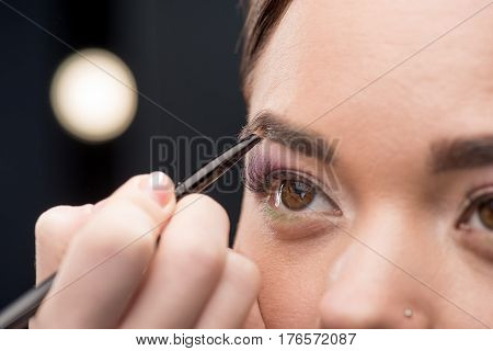Woman Drawing A Shape Of Eyebrow