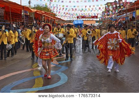 ORURO, BOLIVIA - FEBRUARY 25, 2017: Group of traditional dancers in colourful costumes parading through the mining city of Oruro on the Altiplano of Bolivia during the annual Oruro Carnival.