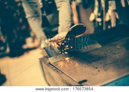 Ski Tuning And Reapairs. Winter Shop Worker Doing Base Repair
