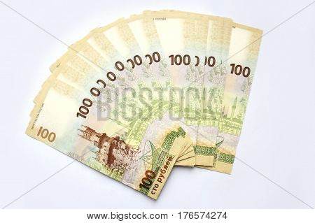 MOSCOW, RUSSIA - AUGUST 1, 2016: New Russian banknote with the Crimea, in denomination of one hundred rubles