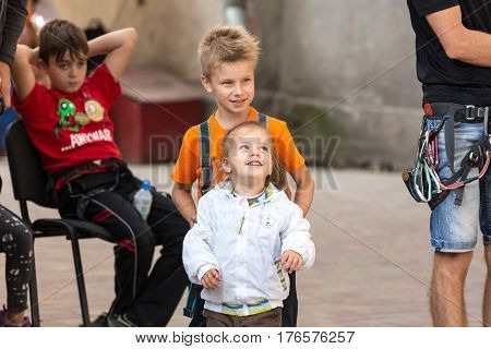Little participants of climbing competitions Brother and Sister watching the performance of other athletes. Family Climbing Competitions Mother, Father and Me , Dnipro, Ukraine, September 18, 2016