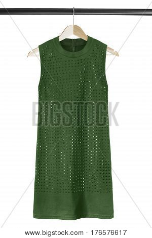 Green mini dress with crystals on wooden clothes rack isolated over white
