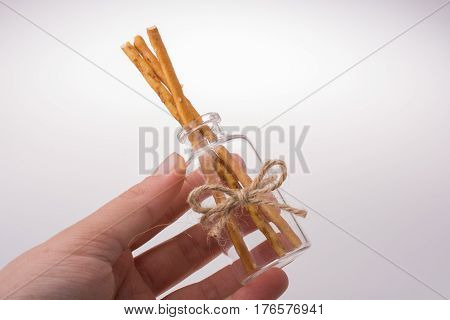 Little Glass With Crackers In Hand