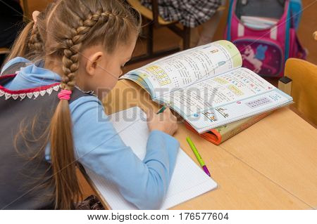 Anapa, Russia - February 28, 2017: First-grader At A Lesson Of Mathematics Writes In A Notebook, Sid