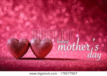 happy mother's day theme with two pink hearts