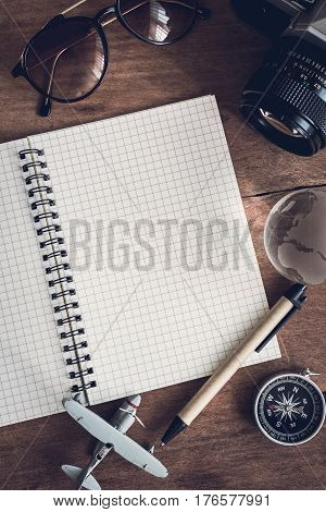 Overhead view of Traveler's accessories and items with notebook and copy space Travel concept