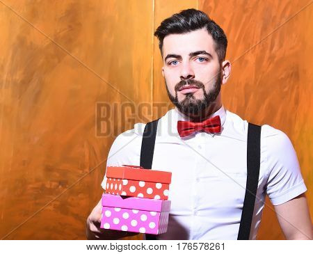 Bearded Man Holding Present Boxes With Serious Face