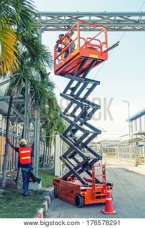Scissor lift platform and electrical technician operated wiring.