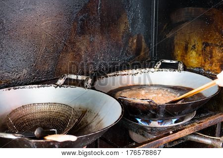 Old oil in the pan and background