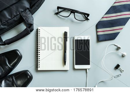 Blank notebook with cellphone desk office in workspace with copy space Top view