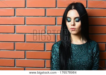 Pretty Woman With Fashionable Makeup In Green Sequins Dress