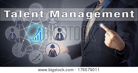 Consultant in blue shirt and business suit is lecturing on Talent Management. Human resources management metaphor and business strategy concept for the anticipation of future staffing requirements.