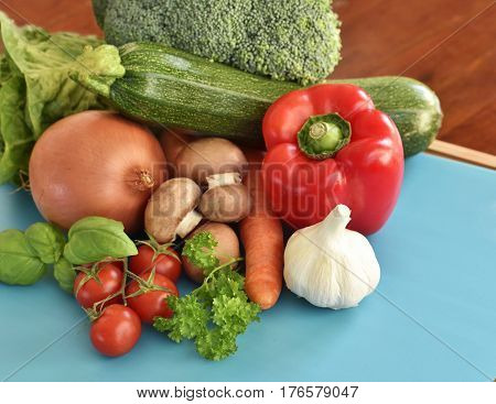Fresh vegetables and fresh fruit on a wooden tablet. Healthy eating background with copy space. High angle view.