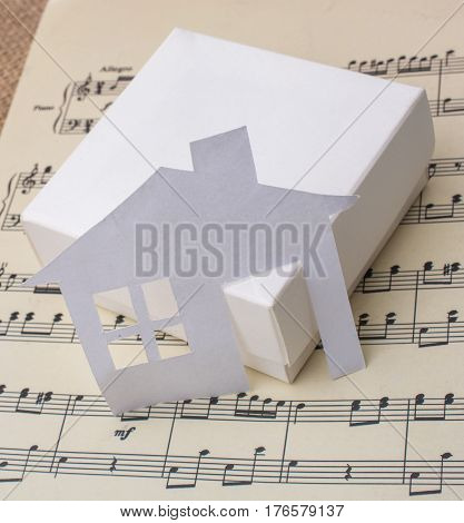 Paper House On A Box A Paper With Musical Notes