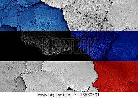 Flags Of Estonia And Russia Painted On Cracked Wall