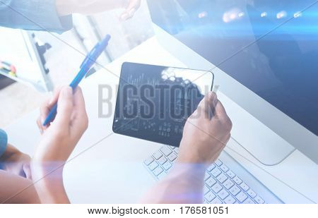 Closeup of female hands holding modern digital tablet.Concept business people using mobile gadgets.Icon and diagramm on the display.Visual effect, color filter, blurred.Horizontal