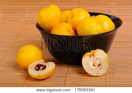 Quince with Black chokeberry in a bowl