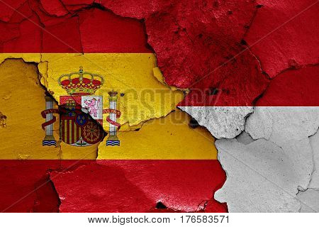Flags Of Spain And Monaco Painted On Cracked Wall