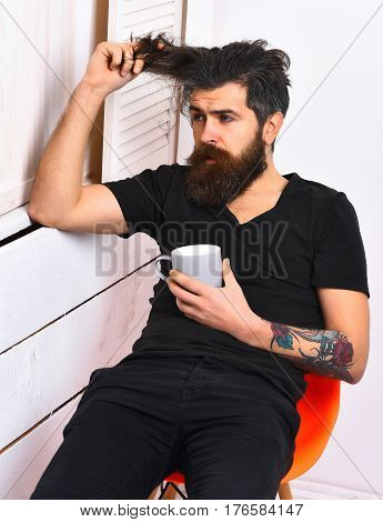 Brutal Tattooed Caucasian Hipster Holding Cup Or Mug