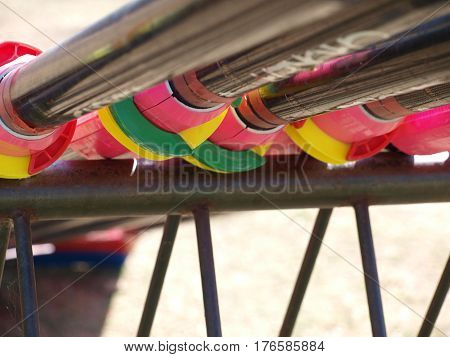 A view from the underside of the equipment rack for rowing orrs. The colorful mounts can be adjusted to set the orrs.