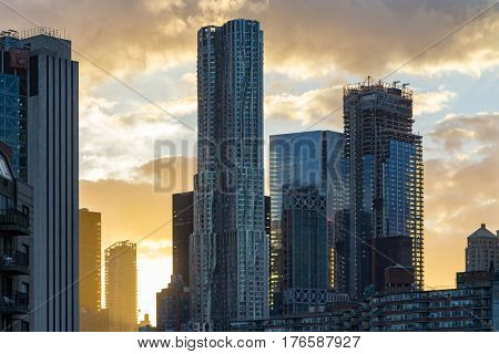 Sunset behind the modern skyscrapers of the downtown New York City skyline in Manhattan