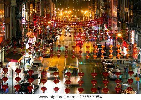 NEW YORK CITY - FEBRUARY 24: The night streets of Chinatown light up with people cars and businesses in Manhattan New York City on February 24th 2017.