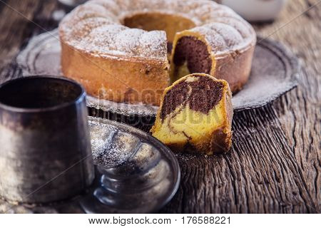 Marble cake.Easter Cake. Marble cake cup of coffee powder sugar and kitchen vintage utensil.