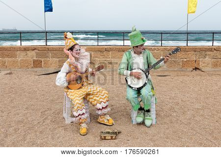 Participants Of Festival Dressed As Clowns Playing Stringed Instruments